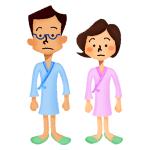 Man and woman wearing hospital gowns