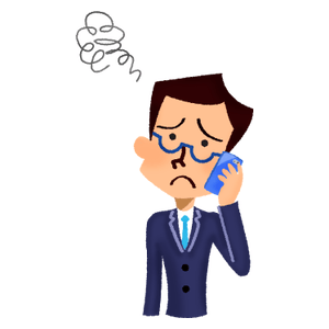 Annoyed businessman talking on cell phone