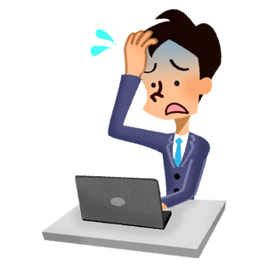 Panicked businessman in front of laptop