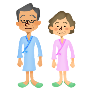 Senior couple wearing hospital gowns