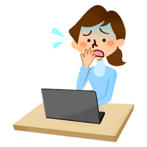 Panicked woman in front of laptop