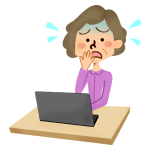 Panicked senior woman in front of laptop