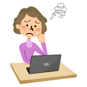 Annoyed senior woman in front of laptop