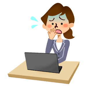 Panicked businesswoman in front of laptop